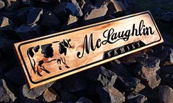Dairy Fence sign macrocarpa with carving of cow and script font