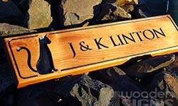 macrocarpa sign carved wiith cat image and V grooved font