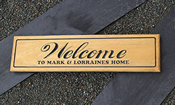 Welcome sign H3 pine carved with black text