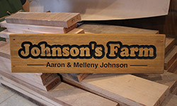 aaron johnson wooden sign example 1000 x 250